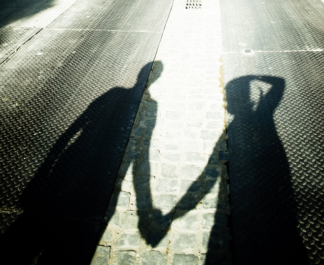 stockvault-shadow-of-a-couple-holding-hands132418